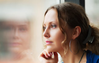woman being mindful looking out of window